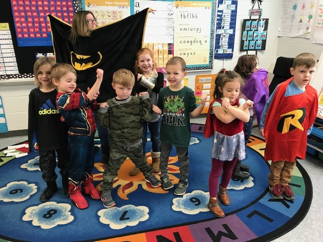 Students in costumes for super hero day