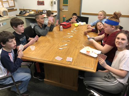students playing spoons