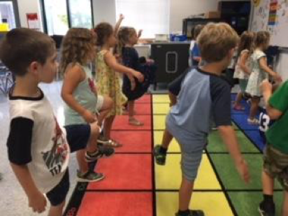 first graders dancing to robot song