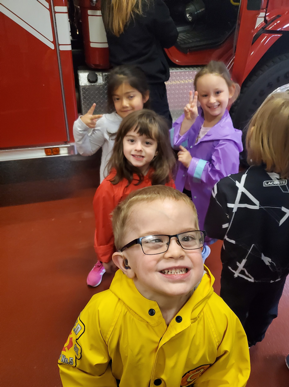 students smiling at firehouse