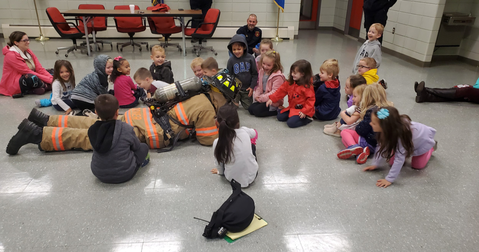 students with a fire fighter
