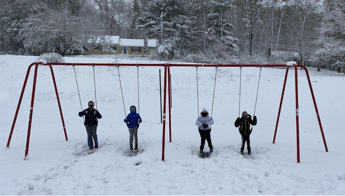 Kids on swings in snow