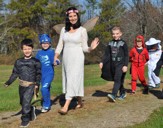 teacher and kids in costumes