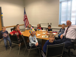 students eating lunch with principal